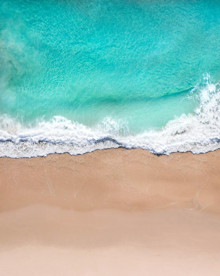 Aerial top shot of a beach with nice sand, blue turquoise water and tropical vibe. Of a superb tropical destination stock photo