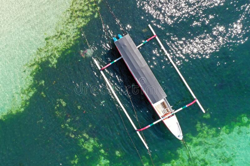Aerial top shot from a traditional boat at the harbor in Bali Indonesia stock images