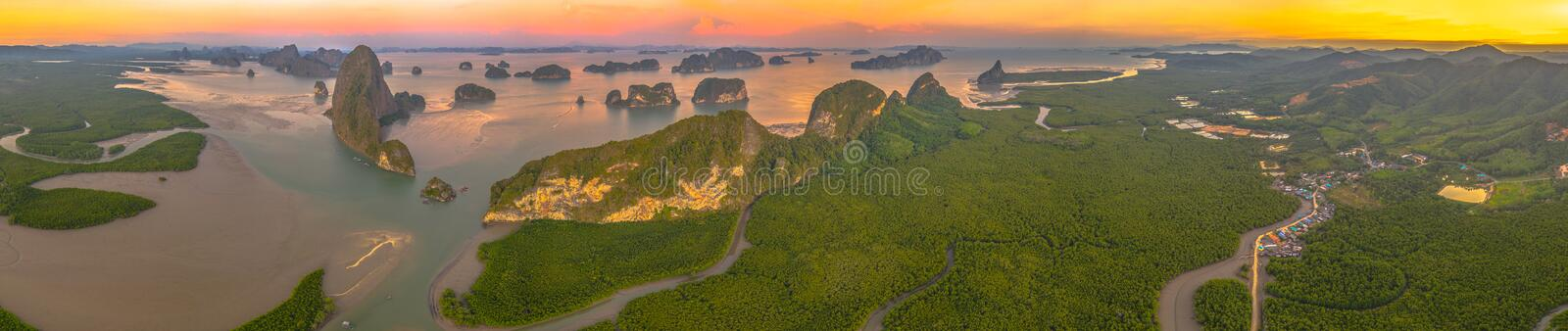 Aerial top view Baan Hinrom pier in mangrove forest at Samed Nangshe archipelago in Phang Nga Thailand. Aerial panorama view sunset at Samed Nangshe archipelago stock photography