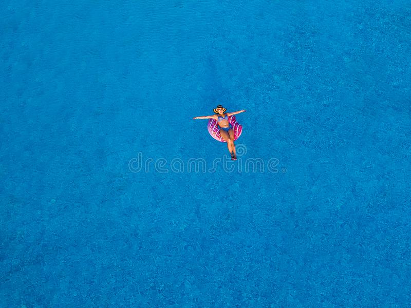 Girl swimming pool royalty free stock photography