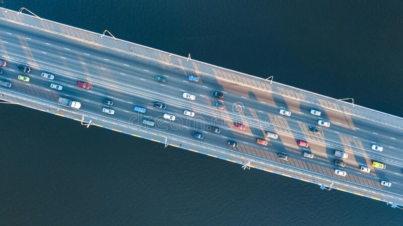 Aerial top view of bridge road automobile traffic jam of many cars from above, city transportation concept royalty free stock photography