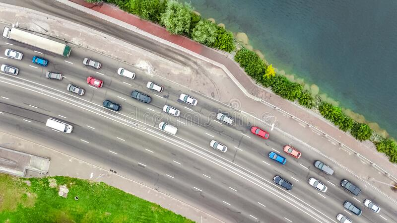 Aerial top view of bridge road automobile traffic jam of many cars from above, city transportation concept stock photo