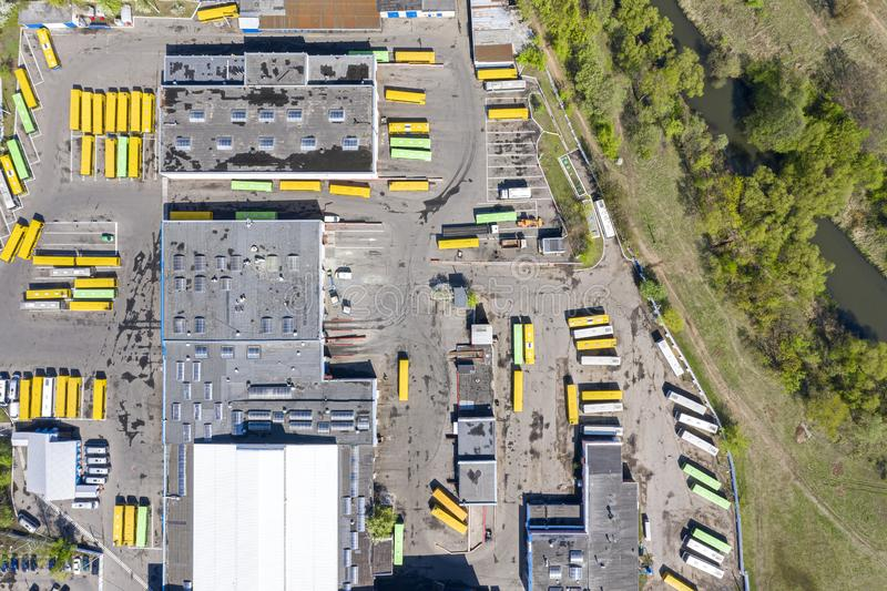 Aerial top view of bus depot with parked buses. Aerial top view of bus depot with garages and parked buses stock photography