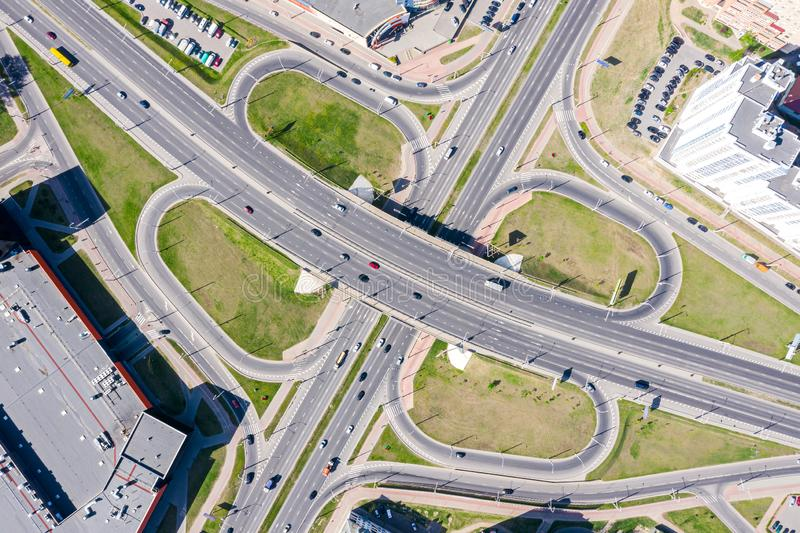 Aerial top view of city highway interchange. road with cars in motion stock photos