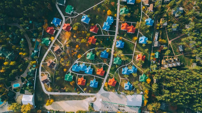 Aerial top view of the colored houses. Country complex. Building. Nature. Relaxation stock photo