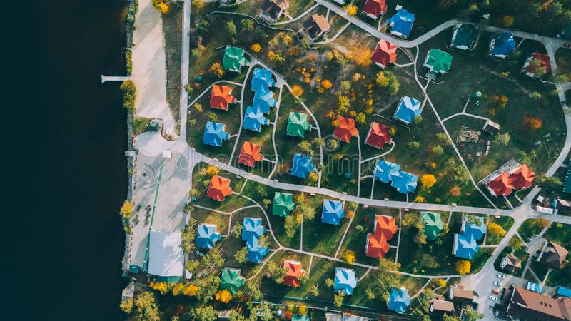Aerial top view of the colored houses. Country complex. Building. Nature. Relaxation. Lake royalty free stock image