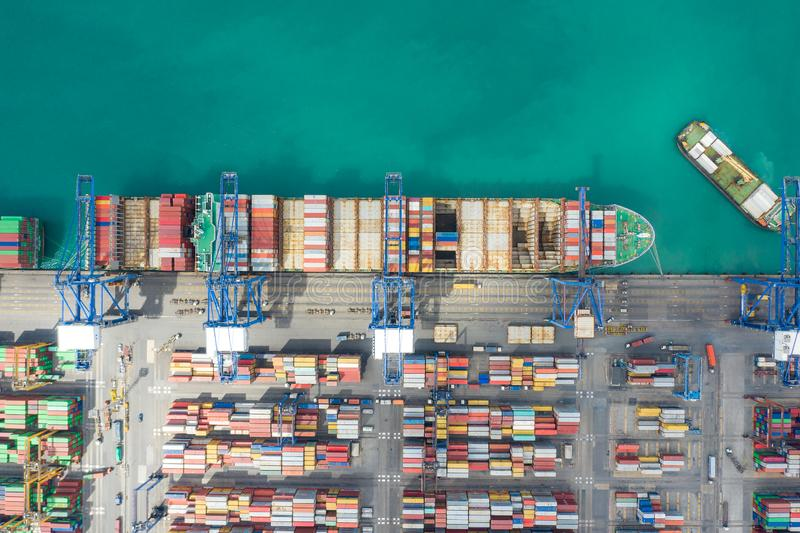 Aerial top view container cargo ship working. Business import export logistic and transportation of International by ship in the stock photo