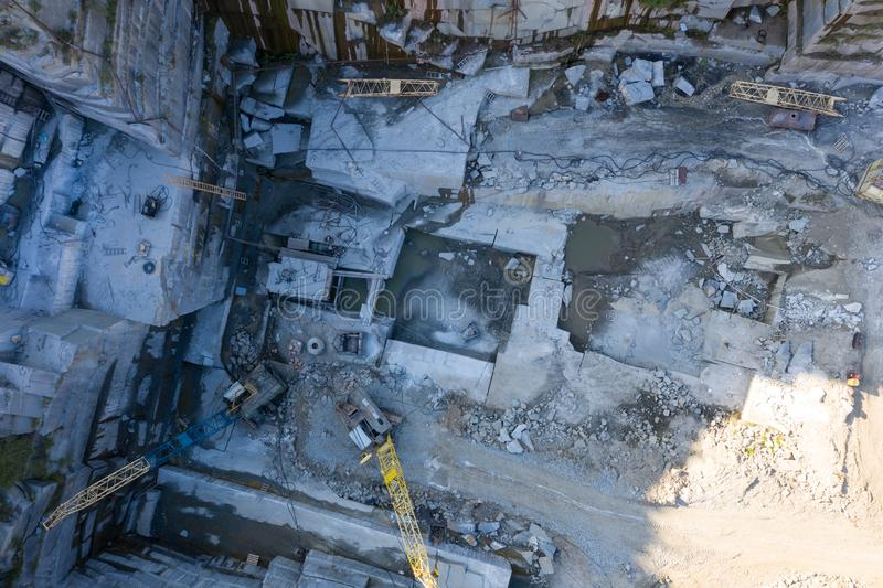 Aerial top view of crushing machinery, conveying crushed granite gravel stone in quarry open pit mining. Processing. Aerial top view of crushing machinery royalty free stock image
