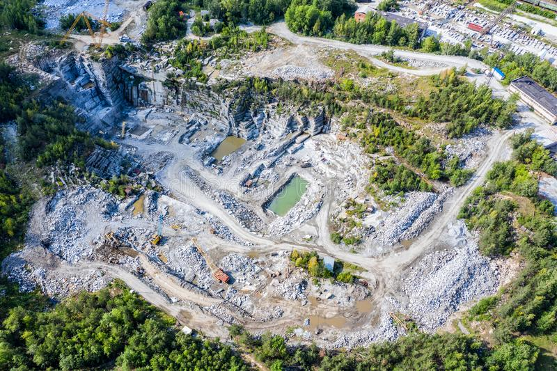 Aerial top view of crushing machinery, conveying crushed granite gravel stone in a quarry open pit mining. Processing. Plant for crushed stone and gravel royalty free stock photos