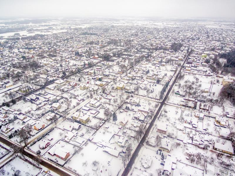 Aerial top view of detached houses in winter royalty free stock photos