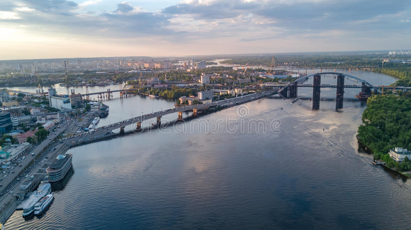 Aerial top view of Dnepr river and Rybalskiy island from above, bridges of Kiev city. Ukraine royalty free stock images
