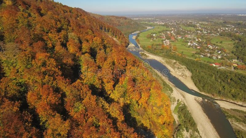 Aerial, top view from Drone: flying over the mountain with forest and river. royalty free stock photos