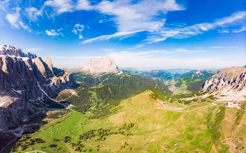Aerial top view from drone to Col Raiser plateau In sunny summer Day. Scenery of rugged Sella Mountain with green valley on grassy. Hillside village St royalty free stock photos