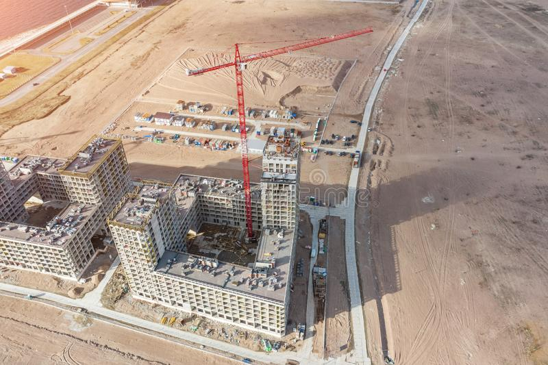 Aerial top view of high-rise residential buildings construction and cranes.  royalty free stock photography