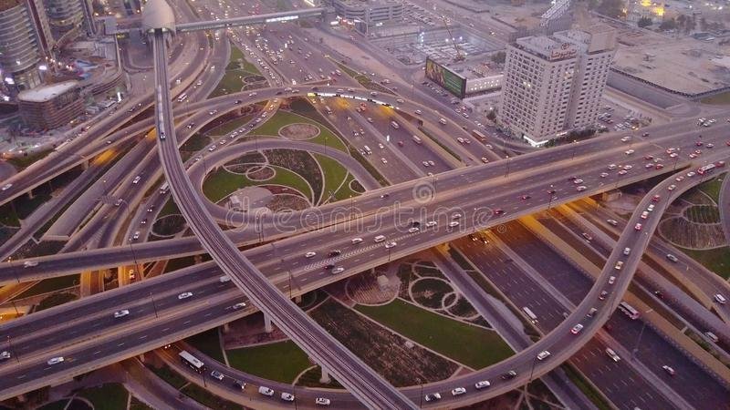 Aerial top view of highway junction with traffic in Dubai, UAE, at sunset. Famous Sheikh Zayed road in Dubai downtown. Transportation and driving concept view stock image
