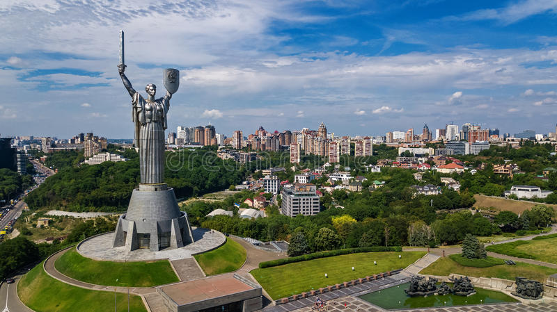 Aerial top view of Kiev Motherland statue monument on hills from above and cityscape, Kyiv, Ukraine royalty free stock photography