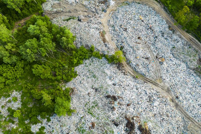 Aerial view of dump in forest. Pollution concept, top view. Aerial top view large garbage pile, Garbage pile in trash dump or landfill, Waste from household in stock photos