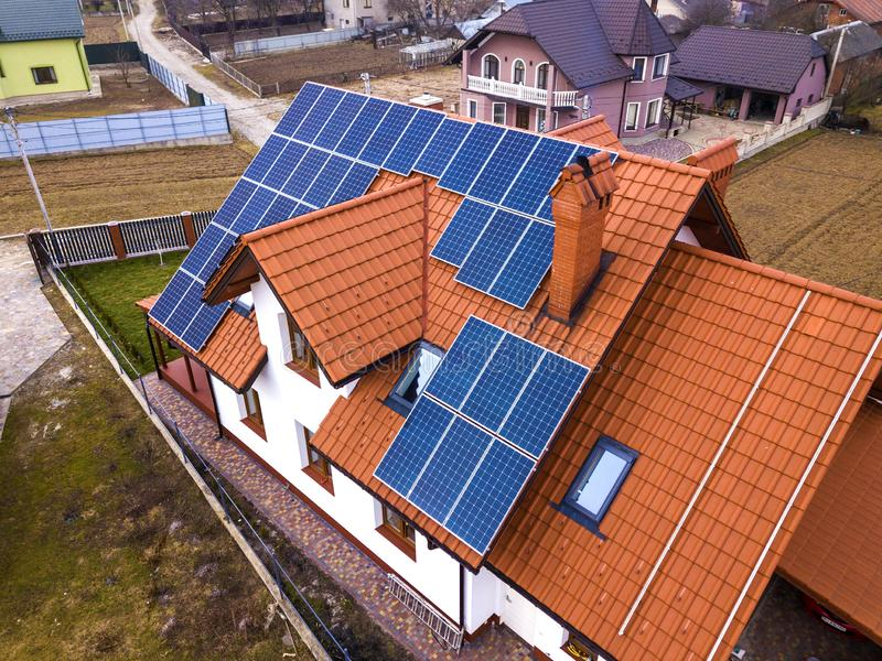 Aerial top view of new modern residential house cottage with blue shiny solar photo voltaic panels system on roof. Renewable stock photos