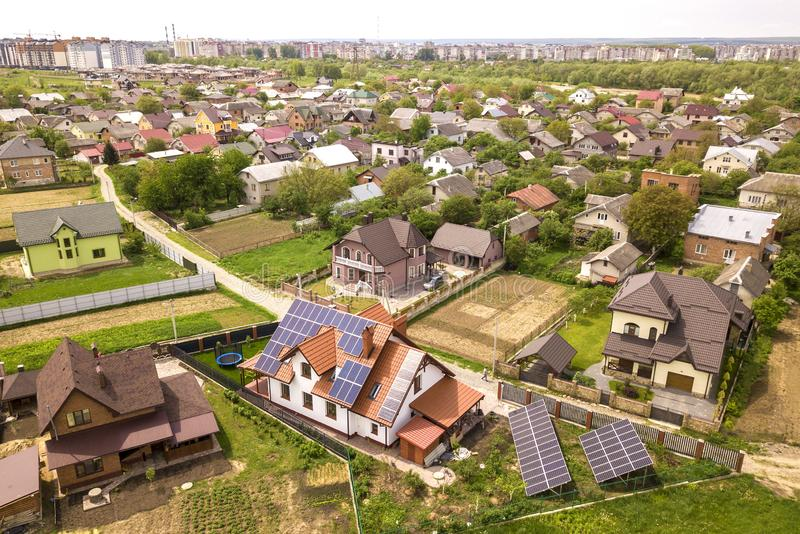 Aerial top view of new modern residential house cottage with blue shiny solar photo voltaic panels system on roof. Renewable royalty free stock photos