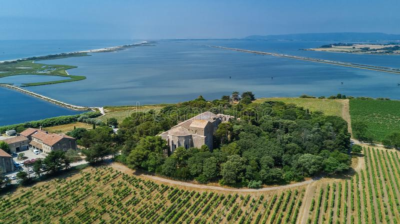 Aerial top view of old church on island from above, canal du Rhone a Sete, Camargue, France stock photos