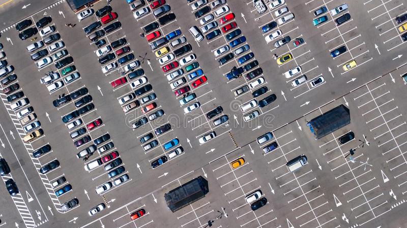 Aerial top view of parking lot with many cars from above, transportation concept stock photography