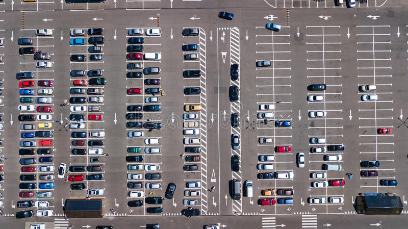 Aerial top view of parking lot with many cars from above, transportation concept. Aerial top view of parking lot with many cars from above, transportation and royalty free stock photography
