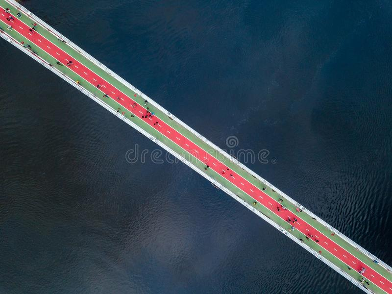 Aerial top view of pedestrian and cycling path lane on Park bridge and Dnieper river from above in city Kyiv , Ukraine. stock photography