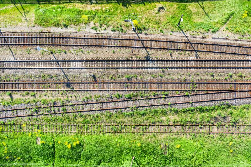 Aerial top view railroad tracks rails and sleepers, several tracks and semaphores royalty free stock images
