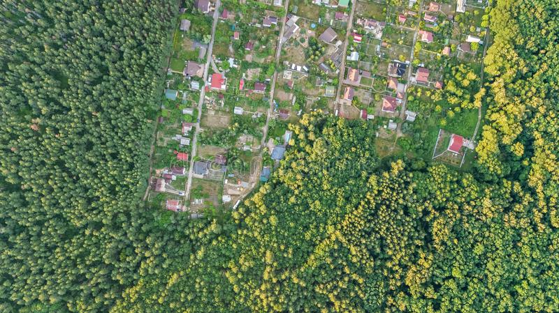 Aerial top view of residential area summer houses in forest from above, countryside real estate and small dacha village in Ukraine. Kyiv stock photos