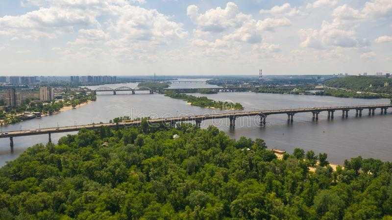 Aerial view of road bridge across the Dnieper River. Aerial top view on road bridge across the Dnieper River in city at summer or spring time. Kyiv, Kiev royalty free stock photos