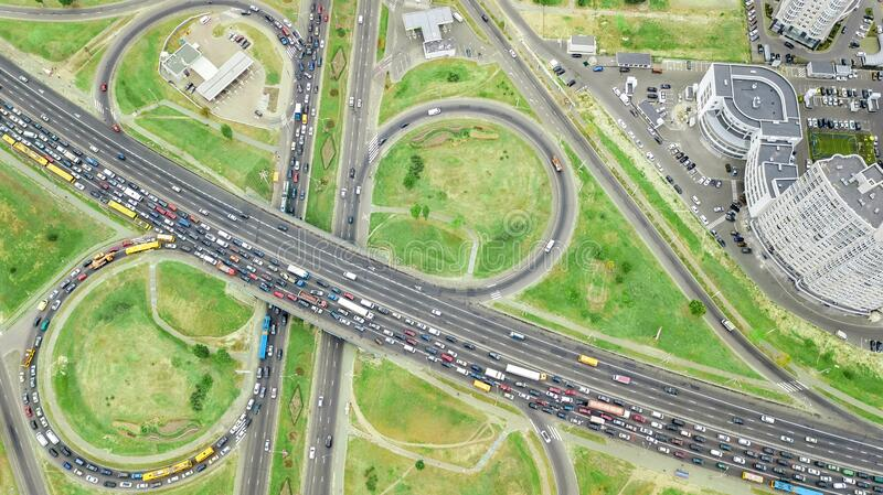 Aerial top view of road junction from above, automobile traffic and jam of many cars, transportation concept, Kiev city skyline royalty free stock image