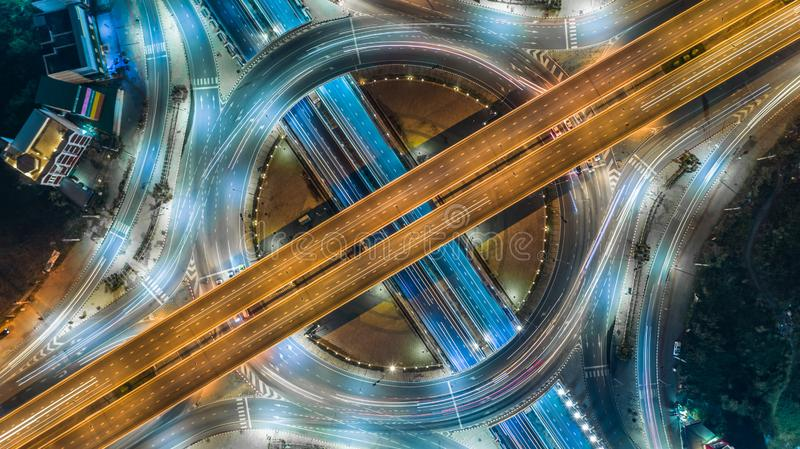 Aerial top view road roundabout intersection in the city at nigh stock photography