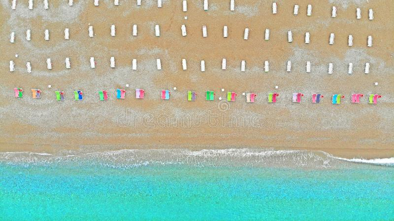Aerial top view of sea beach coastline and deck chairs. Hotel resort and recreation concept royalty free stock image