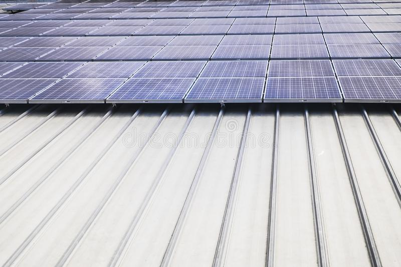 Aerial top view of a solar panels power plant. Renewable energy concept . Detailed close-up of modern large photovoltaic solar stock photo