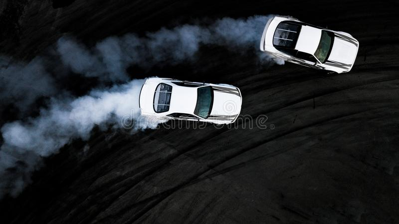 Aerial top view two cars drifting battle on race track, Two cars royalty free stock photography
