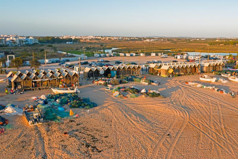 Aerial from traditional fishermen huts on the beach in Armacao de Pera in Portugal. Europe royalty free stock photos
