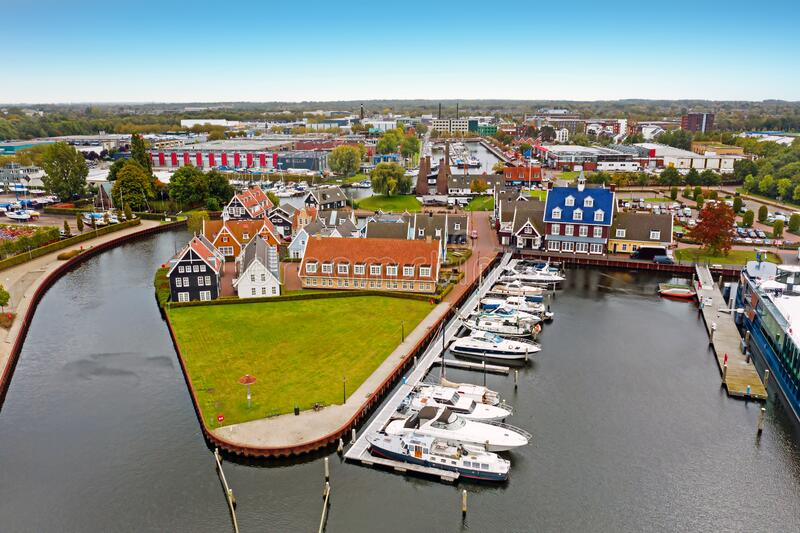 Aerial from traditional houses in the harbor from Huizen in the Netherlands stock photos