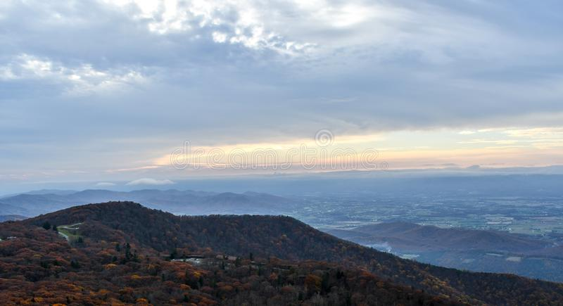 Aerial twilight panorama of mountain forests in autumn colors stock image