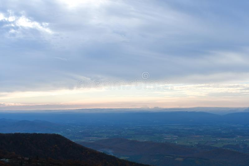 Aerial twilight panorama of mountain forests in autumn colors stock photos