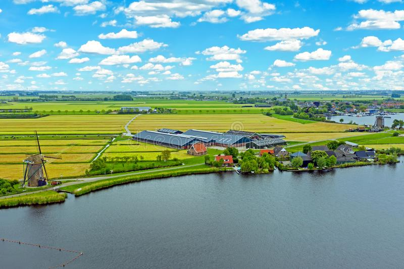 Aerial from a typical dutch landscape with windmills, water en far views royalty free stock image