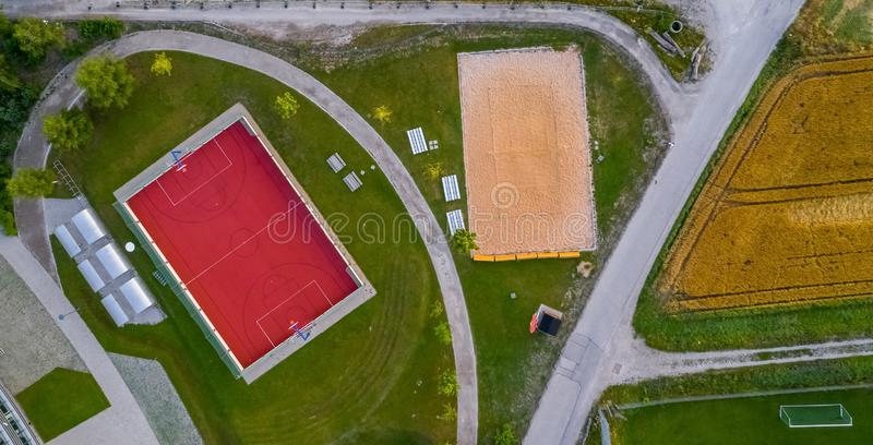 Aerial vertical view of a basketball and beachvolleyball court. stock images