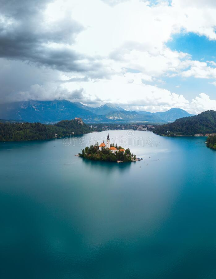 Free Aerial Vertical View Of Lake Bled. Cloudy Weather, Heavy Thunderstorm Clouds On The Horizon. Summer Day. Season Of Tour And Travel Royalty Free Stock Image - 209521706