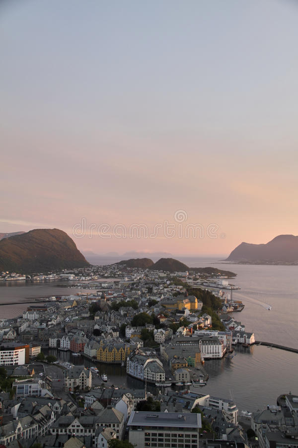 Aerial view of Ã…lesund Norway. Ã…lesund, Norway Aerial view of city. Pink sky sunset royalty free stock photography