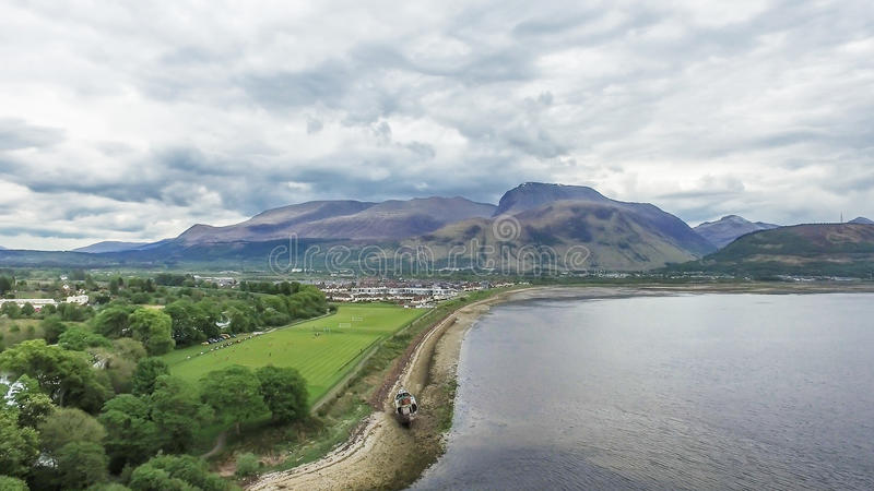 Aerial view of the abandoned ship wreck in Fort William with Ben Nevis in the background. Scotland, United Kingdom royalty free stock image