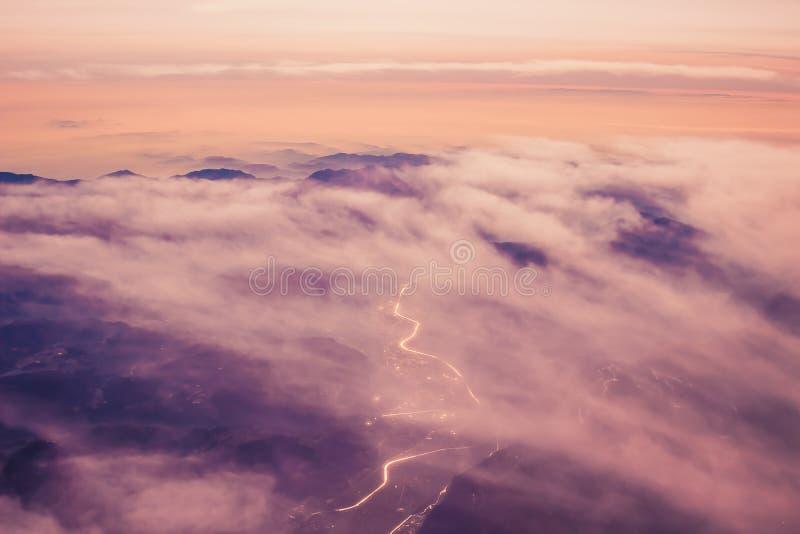 Aerial view above Alpine mountains stock photos