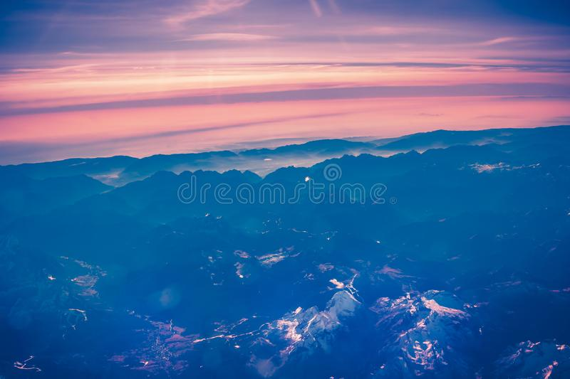 Aerial view above Alpine mountains royalty free stock image
