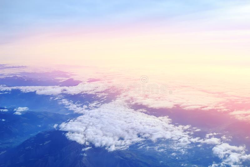 Aerial view above Alpine mountains at sunset royalty free stock images