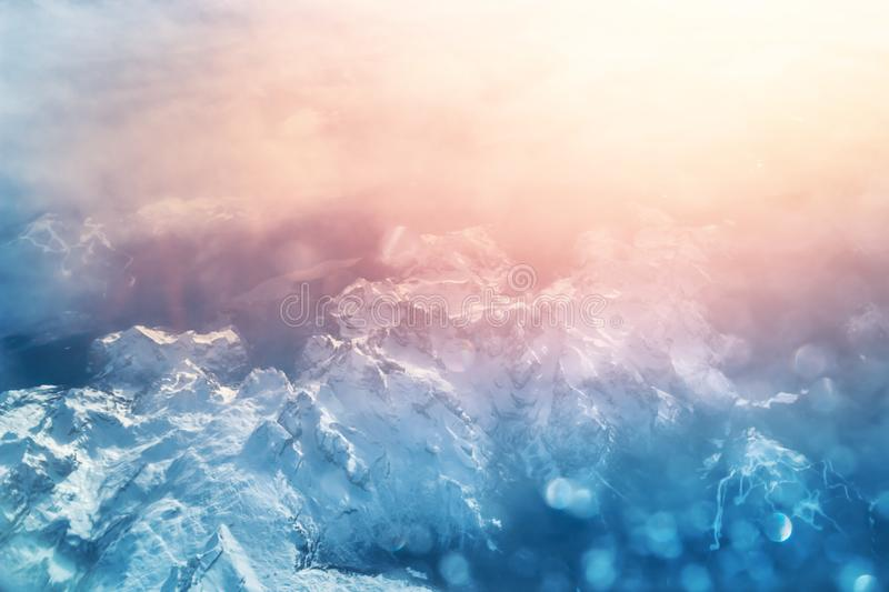 Aerial view above Alpine mountains at sunset royalty free stock photography