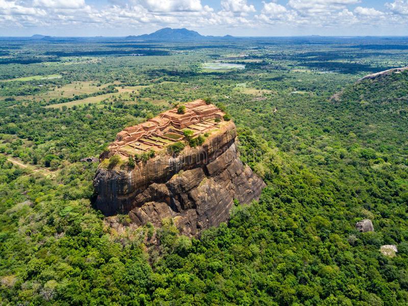 Aerial view from above of Sigiriya or the Lion Rock, an ancient fortress, palace with terracesin Dambulla, Sri Lanka. Aerial view from above of Sigiriya or the stock photo