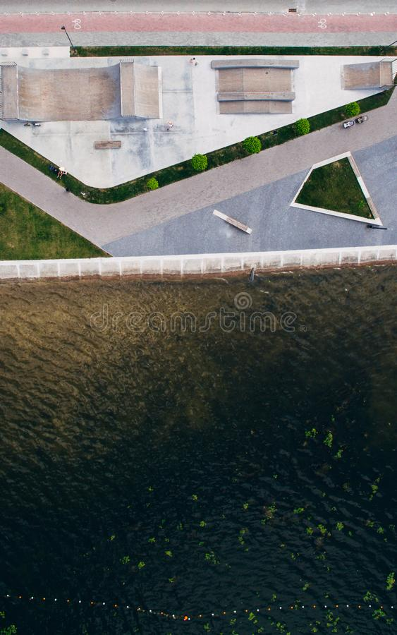 Aerial view from above on the skate park near the lake. Health zone. stock photos